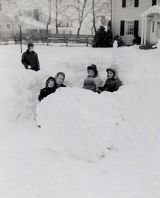 Outside our igloo with my brother (standing) and two neighborhood children.  I'm on the left of my mother.