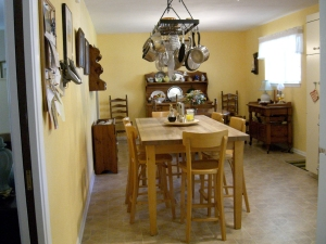 Our kitchen in Texas easily accommodated our big work table and my parents dining room set.