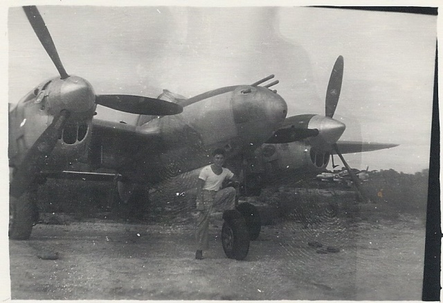 Dad standing in front of the airplanes he worked on.
